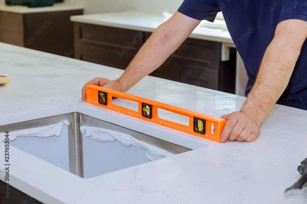 Fototapeta Cabinets with granite countertops renovation and granite installation