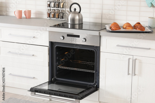 Open empty electric oven in modern kitchen