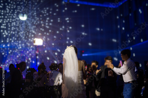 Happy bride dance at wedding party with guests and colour led lighting Fototapet