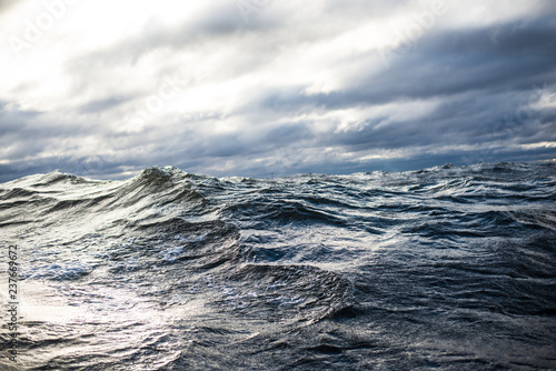 Fototapeta Winter sailing. Cold blue sea at sunset. waves and clouds, Norway obraz