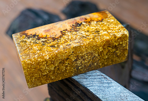 casting epoxy resin burl wood gold color background - Buy this stock
