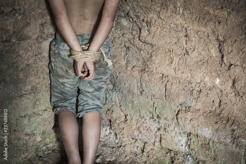 The boy was tied at the corner of the abandoned house, Stop violence against children and trafficking Wallpaper Mural