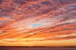 Leinwandbild Motiv Dramatic Sunrise Mackeral Sky with Cirrocumulus Clouds