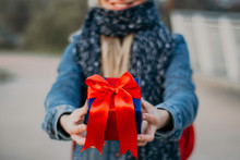 Young Blonde Woman Giving Gift...