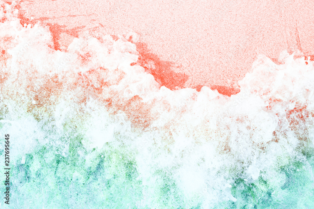Fototapety, obrazy: Soft waves with foam on sandy beach toned in trendy colors of the year 2019. Living Coral and Limpet Shell.