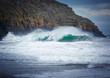 Huge crashing wave near the rocks in Porth Ceiriad near Abersoch, Wales, UK