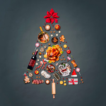 Christmas Tree Made With Various Christmas Food: Turkey On Platter, Roasted Ham, Sweets And Candies, Cookies , Mulled Wine, Gingerbread  Man Decorated With Gift Box And Poinsettia On Gray Background