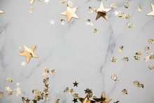 Gold Star Sparkle Party Confetti On A Marble Flat Lay Background