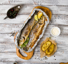 Fresh Baked Fish Sea Bass (Dicentrarchus Labrax) On A Light Wooden Background