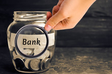 "Glass Jar With Coins And The Inscription ""Bank"". Deposits, Savings And Loans. Additional Capitalization Of Banks. Financed Public Administration. National Bank. Family Savings And Accumulation"