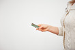 online purchase with a credit card. easy control and money management. woman's hand holding a plastic card