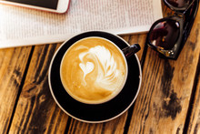 Latte Art In Cup Of Coffee
