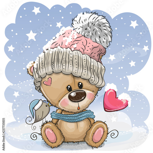 Cartoon Teddy bear in a knitted cap sits on a snow