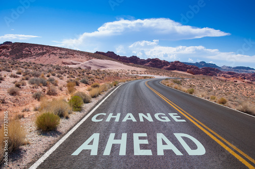 Fényképezés The text Change ahead written on a empty road in the desert of Nevada before t