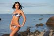 tanned girl on a wild wild beach