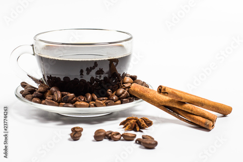 Salle de cafe Glass cup with coffee, cinnamon sticks and grains on a white background