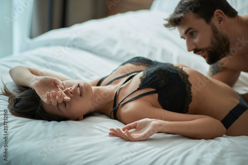 Man and woman in bed making love
