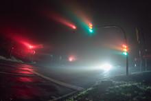 Traffic Lights In A Foggy Night