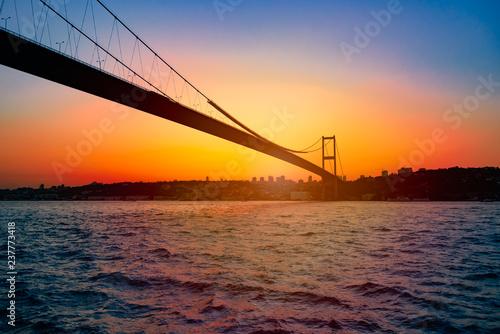 Fotografie, Obraz Bosphorus Bridge at sunset in Istanbul, Turkey