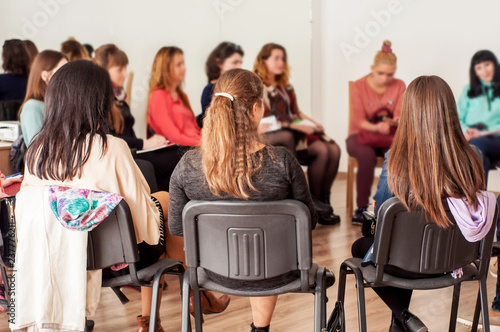 Fototapeta Group of young women talking sitting in a circle. Psychological support obraz