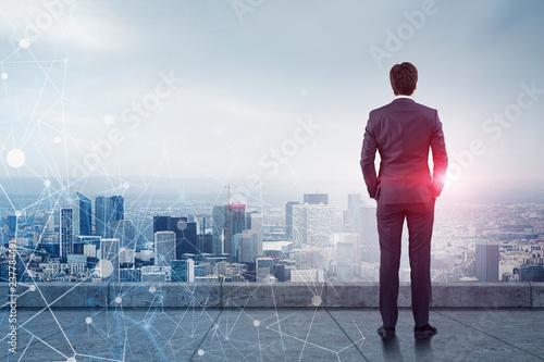 Businessman looking at city, network Wallpaper Mural