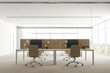 Panoramic office with beige tables