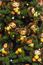 Christmas Trees Decorated With Toys And Flowers. Beautiful Winter Trees. Plush Toy Cheburashka.
