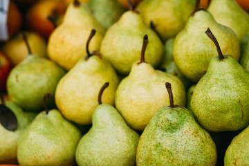 Green Ripe Pears At A Farmers Market. Heap Of Fruits