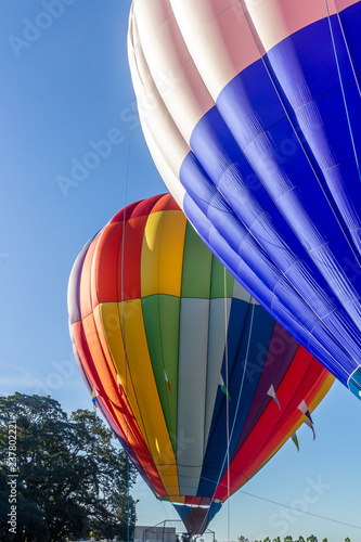 Fotografia, Obraz  2 hot air balloons are preparing to launch