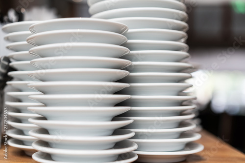 Fotografia, Obraz  Pile of white plates in restaurant, close up
