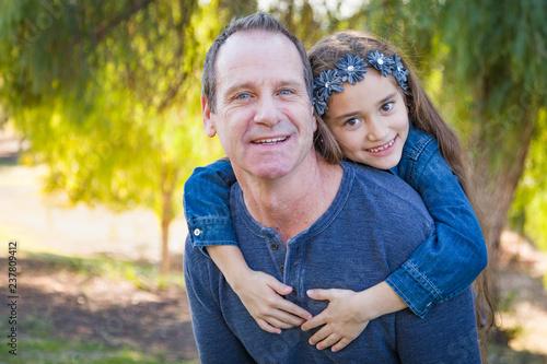 Fotografie, Obraz  Cute Young Mixed Race Girl And Caucasian Grandfather Having Fun Outdoors