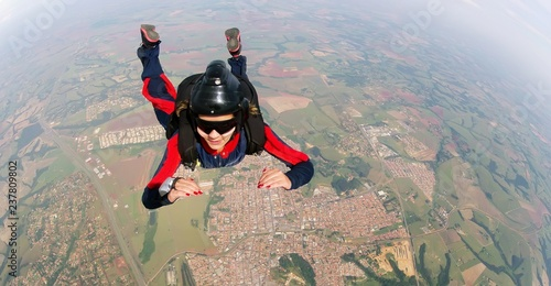Empowered woman jumping from parachute.