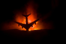 Air Crash. Burning Falling Plane. The Plane Crashed To The Ground. Decorated With Toy At Dark Fire Background. Air Accident Concept.