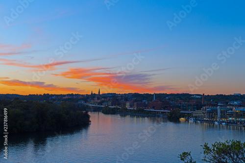 Obraz na plátne Bright autumn sunset over Georgetown waterfront in Washington DC, USA