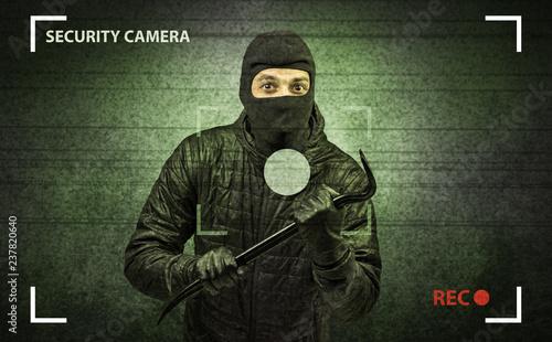 Fotografía  Caught burglar by house camera in action.