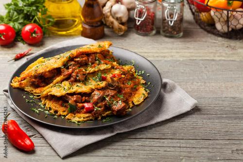 Hungarian potato pancake with goulash