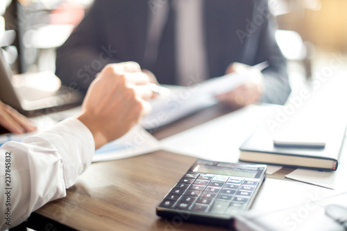Fotografía  Businessman work with computer on table in office