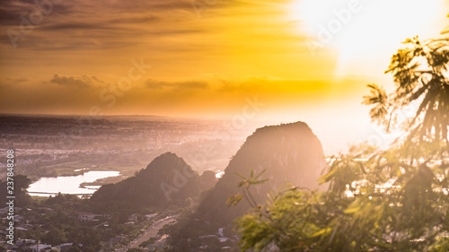 Foto auf Leinwand Orange Beautiful sunset in the Marble mountains in Da Nang ,charming view for the city,jungle and sea,travel concept.