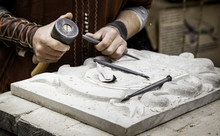 Carving Stone In A Traditional...