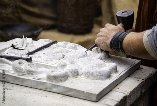 Stampa su Tela Carving stone in a traditional way