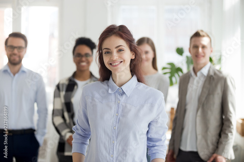Fotografía Portrait of smiling millennial female employee or worker looking at camera, happ