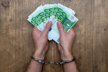 Hands In Handcuffs With  Money