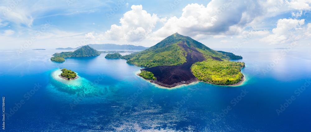 Fototapeta Aerial view Banda Islands Moluccas archipelago Indonesia, Pulau Gunung Api, lava flows, coral reef white sand beach. Top travel tourist destination, best diving snorkeling.