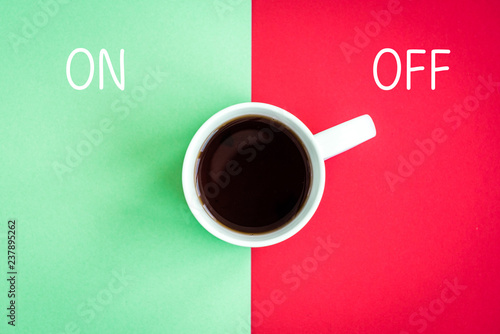 Photo  Cup of coffee with abstract on off switch on green and red background