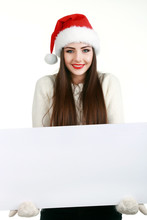 Young Woman In Santa Claus Head And Holding Chalkboard Over White Background