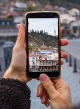 Woman Hands Take Phone Photo Of Tbilisi City On Georgian. Maidan Old District Square On Smartphone Photography.