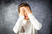 Portrait Of A Little Boy Covering His Eyes