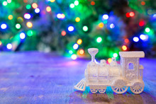 Silver Christmas Train On A Background Of Multi-colored Bokeh.