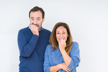 Beautiful Middle Age Couple In Love Over Isolated Background Looking Stressed And Nervous With Hands On Mouth Biting Nails. Anxiety Problem.