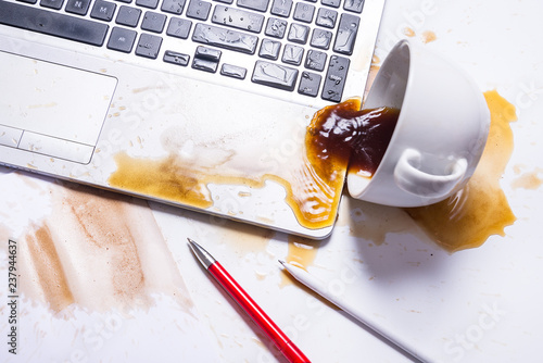 Fotografering  Spill coffee on a computer keyboard